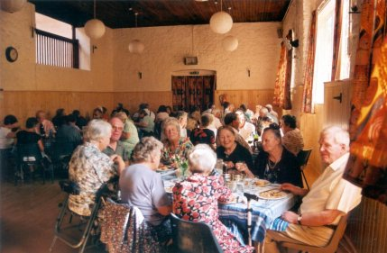 A picture of volunteers, listeners and members of the public enjoying a hearty fundraising meal at Biddenham Village Hall