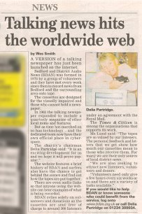 Newspaper cutting describing the BDAN website launch - headline 'Talking News Hits the Worldwide Web', with a photograph of Delia Partridge leaning on a computer monitor with cassettes in her hand, December 2004