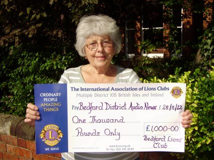 Janet Cook poses with a cheque for £1,000