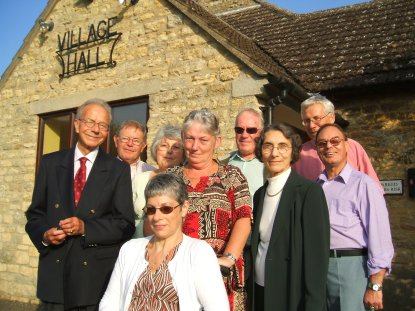 An image showing a group of people outside Biddenham village hall, after the charity's annual lunch and raffle in 2007