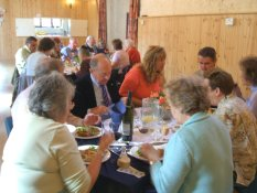 Wide shot of volunteers, supporters and listeners eating at the 2007 charity lunch, Biddenham