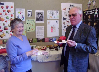 Volunteers Sue Barrow and David Mitchell eating cake at the 2011 AGM