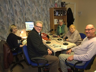 Image of a team preparing to record - Ann & Dennis Craddock, and Cecil Parry with studio operator Robin Grewer, in the foreground left