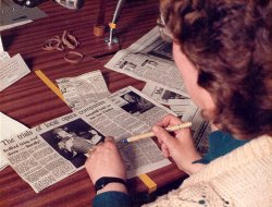 Image showing a BDAN reader checking newspaper text in the studio