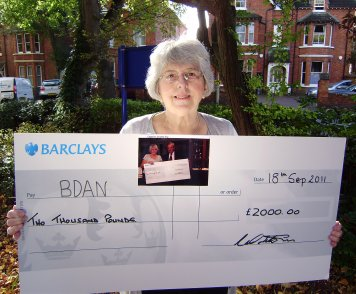 Janet Cook with a large-size cheque